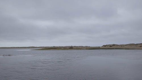 Calm Lake Under A Grey Sky