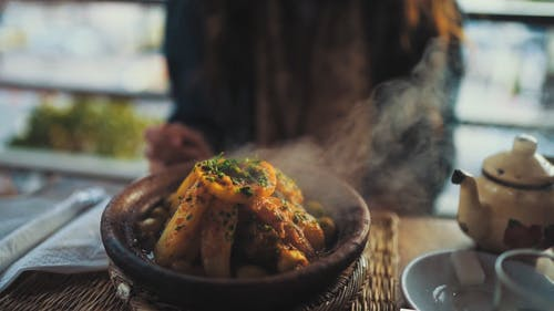 Close-up Footage Of A Hot Dish On A Clay Pot