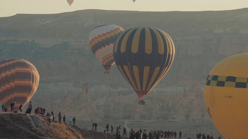 People Watching  Hot-Air Balloons Up In The Sky