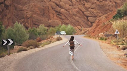 Woman Walking In The Middle Of The Road
