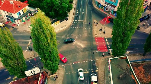 Drone Footage Of A Busy Intersection Of Road In An Urban Area