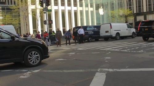 Pedestrians Waiting For Traffic Light To Cross A Street