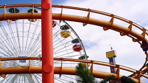 Carnival Rides Operating In An Amusement Park