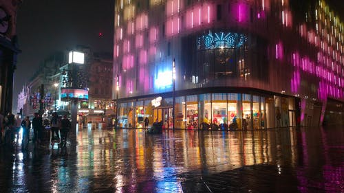 People Outside The Streets On A Rainy Night