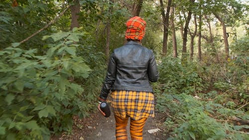 Backside Of A Woman Walking In The Woods