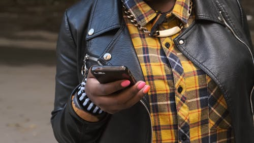 A Woman Using Her Cellphone