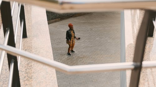 A Woman Dancing On The Ground Floor Outside Pavement