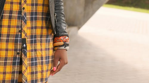 A Woman Her Phone Wearing A Leather Jacket And Jewel Accessories