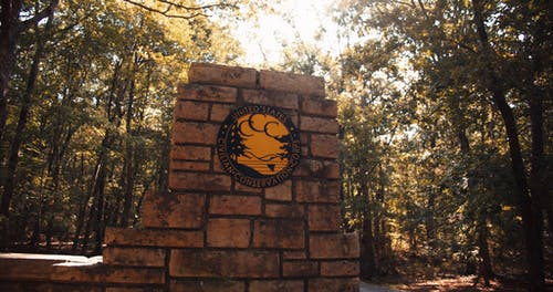 A Symbol Of The Civilian Conservation Corps On A Wall