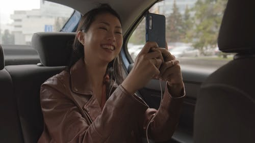Woman Having A Video Chat While Inside A Car