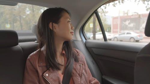 Woman Having Coffee Inside A Car