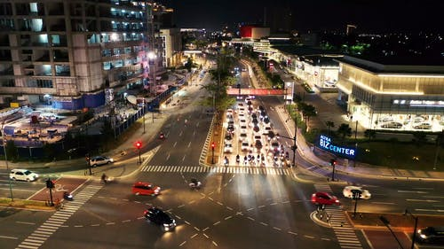 Aerial Footage Of Vehicular Traffic Of A Busy Street Intersection At Night