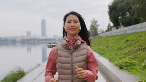 A Woman Wears A Smile While Jogging