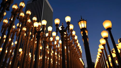 Rows Of Lighted Outdoor Lamps On A Street  For Attraction