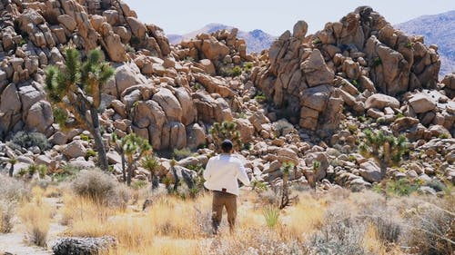 A Person Moving Towards The Natural Rock Formations