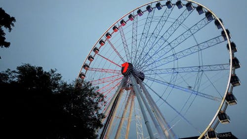 An Observation Wheel Spinning In Operation