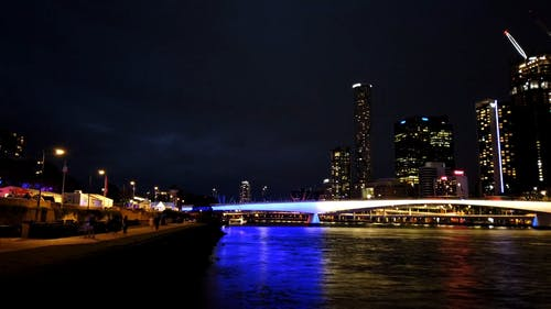 View Of The City Buildings From Across The River At Night