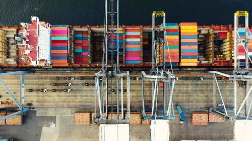 Heavy Machinery Used In Seaports Unloading Containers From A Cargo Ship
