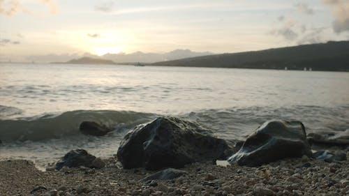 Slow Motion Footage Of Breaking Waves On Rocky Seashore