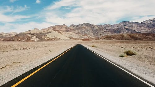 Dash Camera Footage Of Traveling A Road Built On A Desert