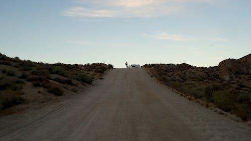 A Vehicle Having A Break  Down On A Desert Land