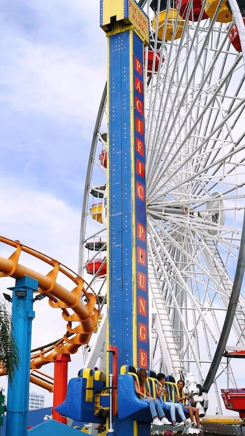 A Free Fall Amusement Ride In An Amusement Park