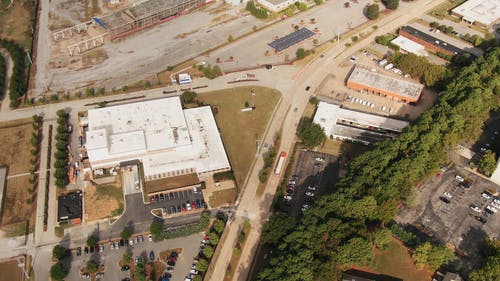 Aerial Footage Of Warehouses Construction In A Business District