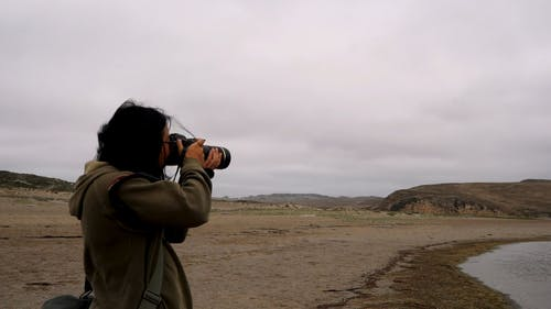 A Photographer Taking Shot Of Nature Using a Modern Camera
