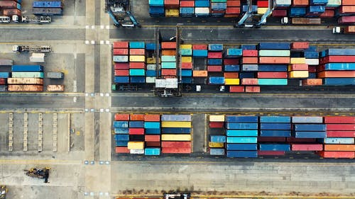 Cargo Containers Pile In Rows Inside A Sea Harbor