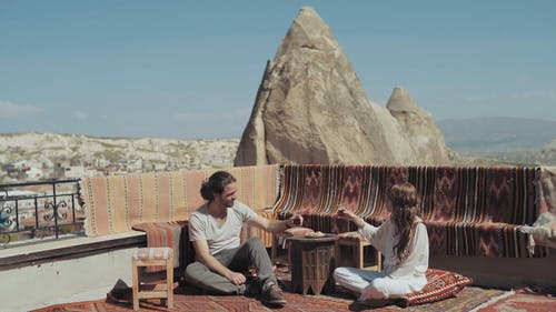 A Couple Having A Date On A Carpeted Rooftop