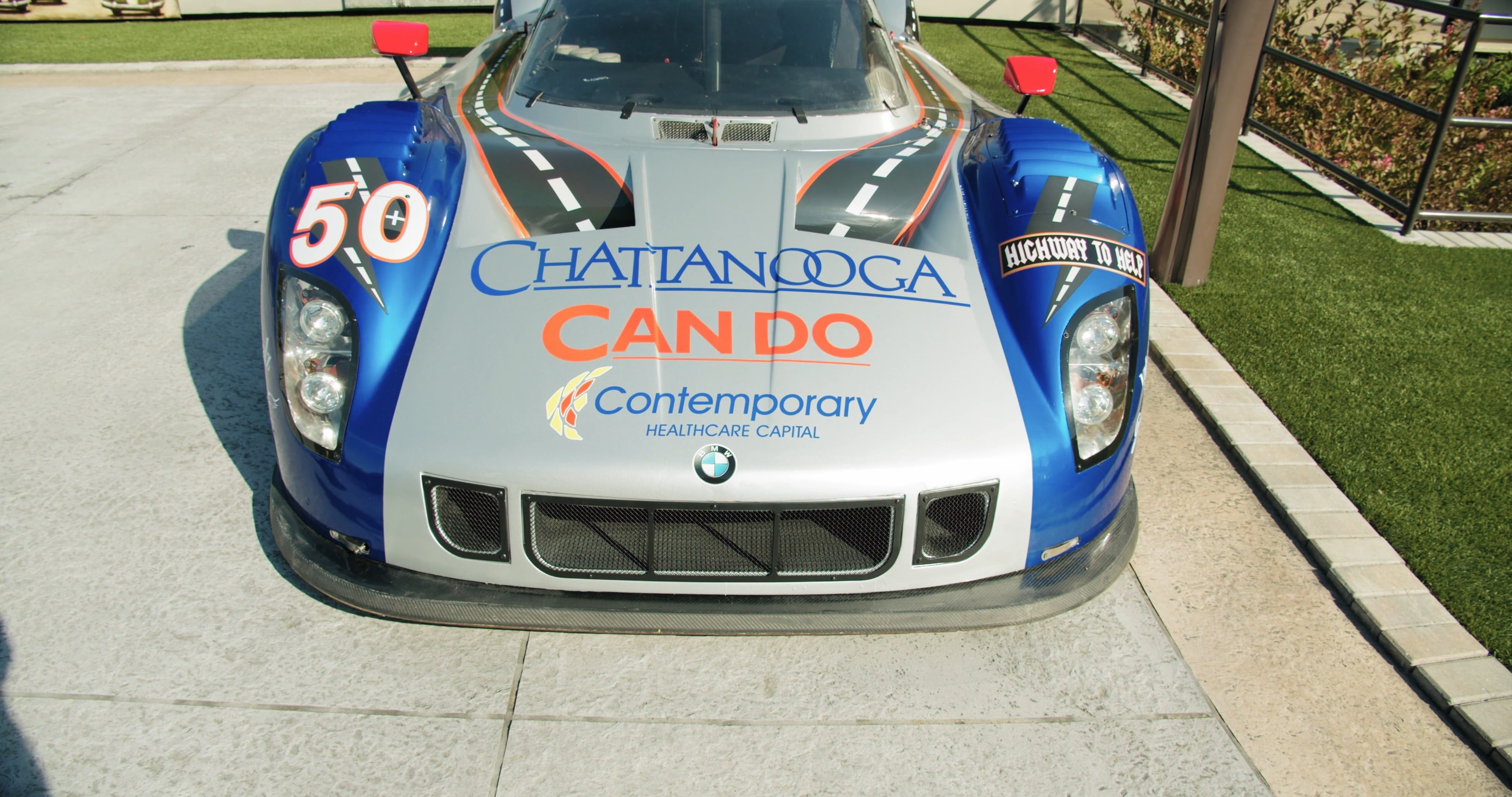 A Racing Car On Display Outdoors In A Car Show Free Stock Video