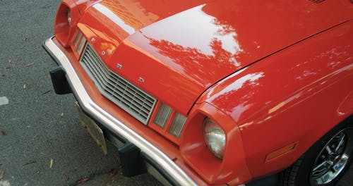 Close-up Of The Front End And Chrome Wheel Of A Old Red Ford Car
