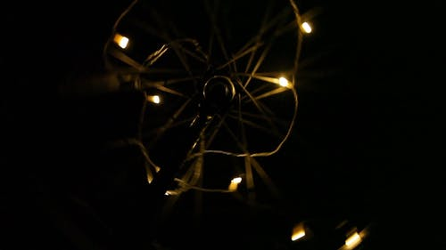 Lights Attached To A Spinning Tire Of An Inverted Bicycle