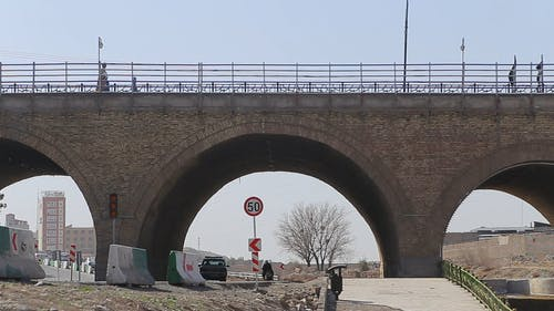 Roads Construction Under The Arched Pillar Of A Bridge