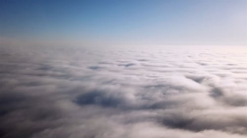 Drone Flying Above The Sea Of Clouds