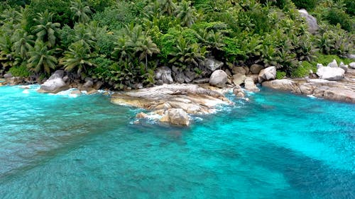 Beach With Clear Blue Water