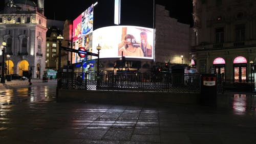 Electronic Billboards Showing Commercial Advertisement At Night