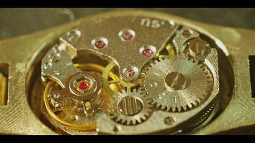 Close-Up View Of  Mechanism Of A Watch