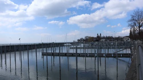 Time Lapse Footage Of Clouds Over A Marina At Daytime