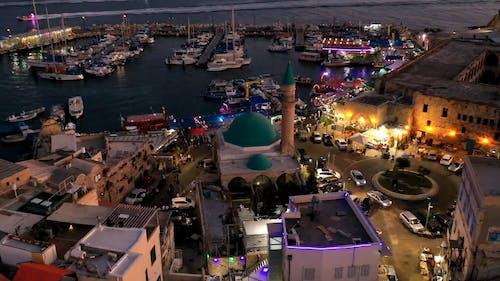 A Busy Night Market At The Sea Bay