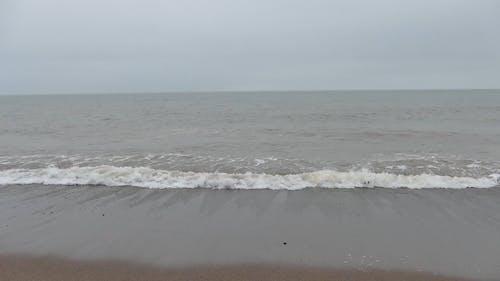 Waves Kissing The Shore Produces Sea Foam Bubbles