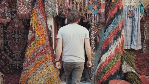 Man Entering A Store Of Textiles And Souvenirs