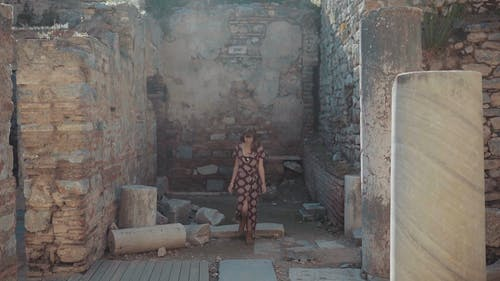 A Woman Touring An Ancient Ruin In Turkey