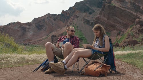 A Couple Relaxing While On An Adventure