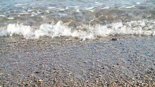 Waves Breaking On Pebbly Seashore