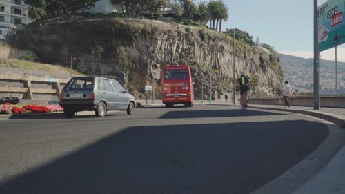Vehicles Traveling Downhill Towards A Curve