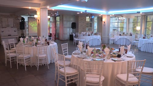 Table Set-up And arrangements For A Wedding Reception