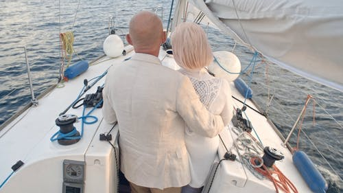 Backside Of A Couple In A Loving Embrace On A Seaborne Sailboat