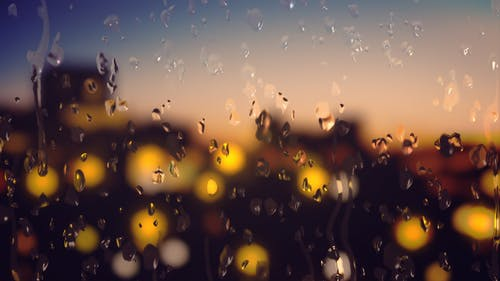 Water Droplets Sliding Down A Glass Window