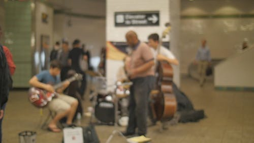 A Musical Band Performing On The Subways Platform